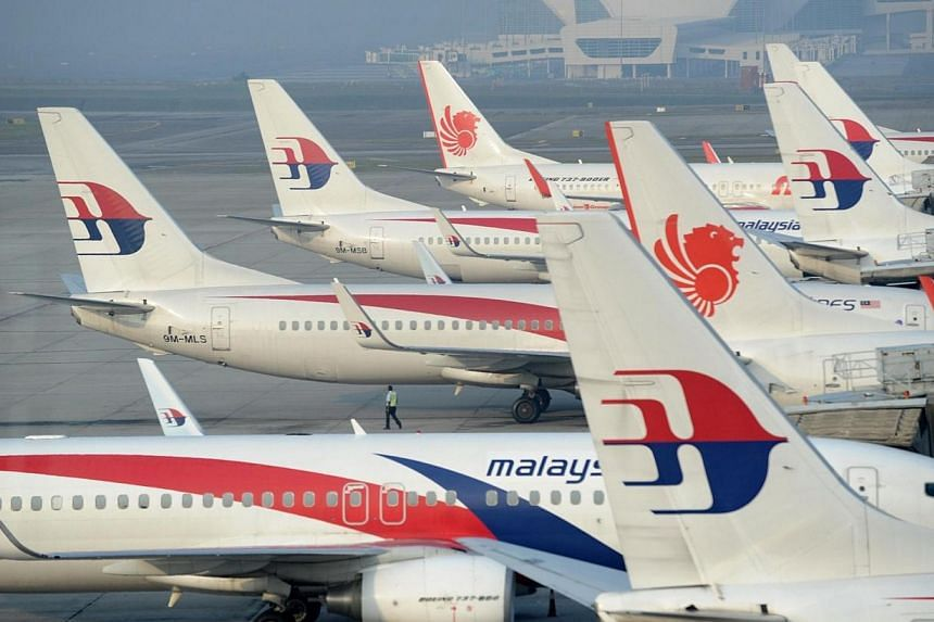 Malaysia Airlines planes parked at the terminal in Kuala Lumpur Intenational Airport (KLIA) in Sepang on March 30, 2014. A Malaysia Airlines plane's wheels refused to stow after take off Thursday, April 24, 2014, forcing a second flight by the flag-c