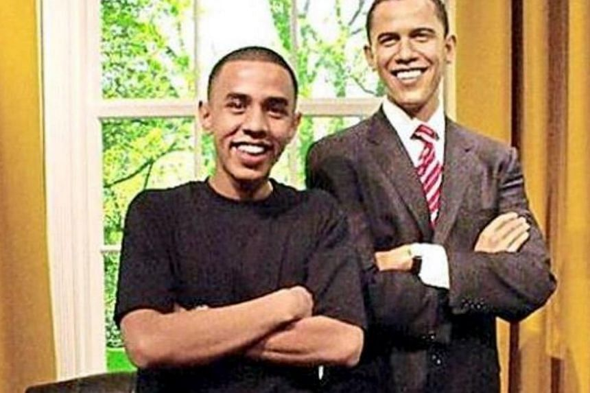 Seeing double: Iman Ishak posing with a wax figure of US President Barack Obama. -- THE STAR/ASIA NEWS NETWORK