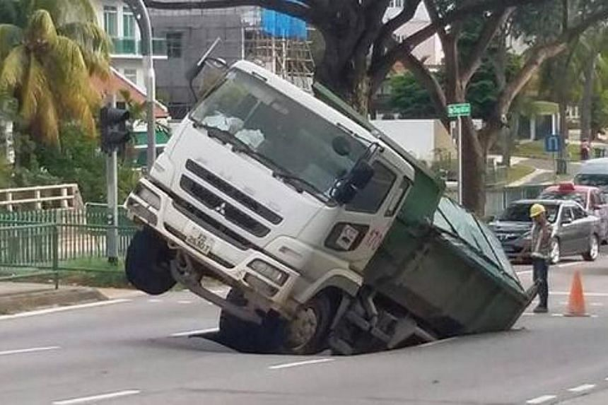 A section of Upper Changi Road East near Jalan Demak has caved in. -- PHOTO: ANDRE GIAM/ TWITTER