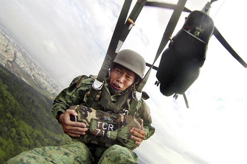 Lieutenant Tan Kay Jek's face tautening as he plunges through the air over Sembawang Air Base. -- ST PHOTO: ALPHONSUS CHERN