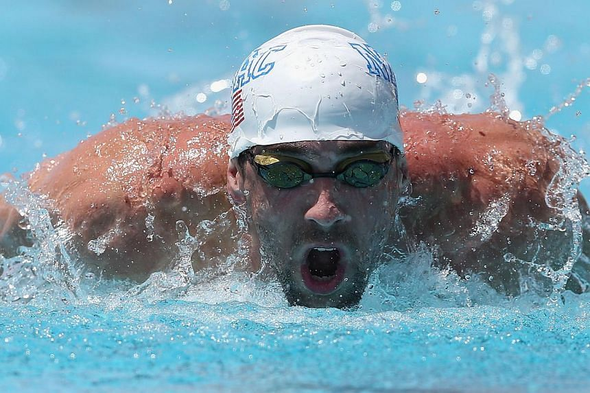 Michael Phelps competes in the Men's 100m Butterfly Prelim during day one of the Arena Grand Prix at the Skyline Aquatic Center on April 24, 2014 in Mesa, Arizona. -- PHOTO: AFP