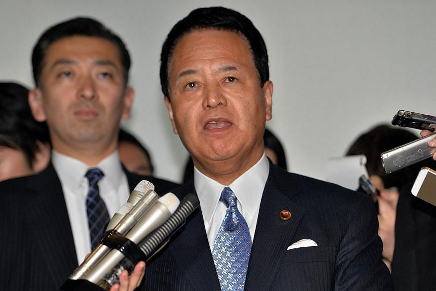 Japanese State Minister in charge of Trans-Pacific Partnership (TPP) Akira Amari (centre) is surrounded by reporters after he met with US trade representative Michael Froman at Amari's office in Tokyo on April 24, 2014. Amarisaid Friday that To