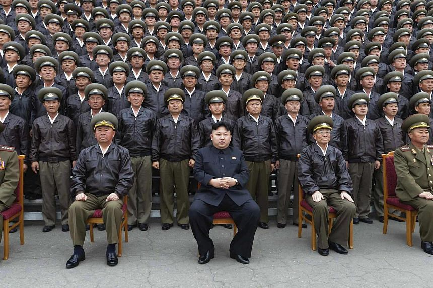 North Korean leader Kim Jong Un (front row, centre) poses for a picture with senior military staff and other participants of the first meeting of the airpersons of the Korean People's Army (KPA) in Pyongyang April 17, 2014.. North Korea appears to be
