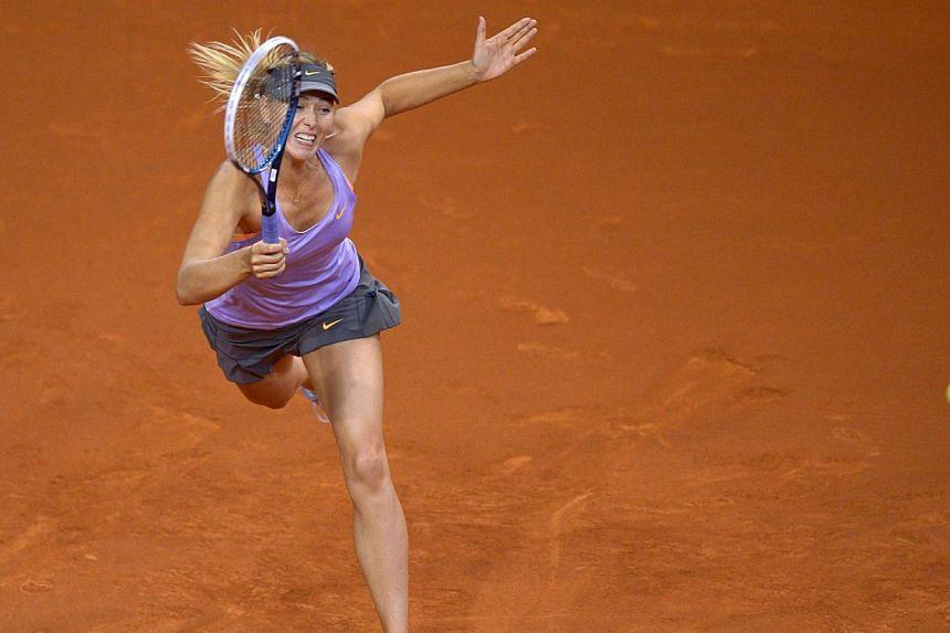 Russia's Maria Sharapova returns the ball to Russia's Anastasia Pavlyuchenkova in their match at the WTA Porsche Tennis Grand Prix in Stuttgart, southwestern Germany, on April 24, 2014.Sharapova reached the last eight of the Stuttgart WTA tourn
