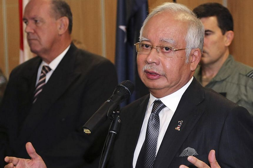 Malaysia's Prime Minister Najib Razak speaks at a breakfast with crews from nations involved in the search for Malaysia Airlines flights MH370 at RAAF Base Pearce in Perth, on April 3, 2014. -- FILE PHOTO: REUTERS