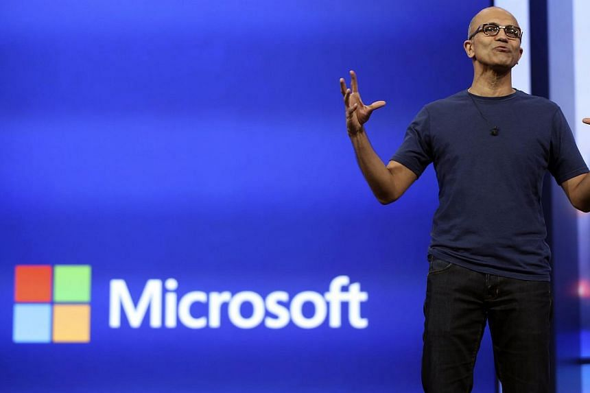 Microsoft CEO Satya Nadella gestures as he speaks during his keynote address in San Francisco, California on April 2, 2014. Microsoft on Thursday reported quarterly profit slipped as lifestyles continued to shift from personal computers to mobil