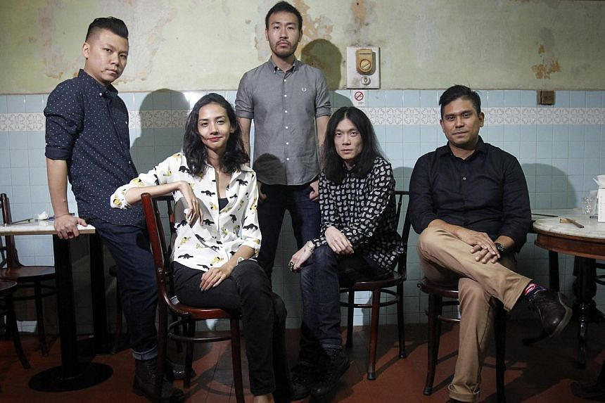 Poet Jennifer Anne Champion (second from left) and singer-songwriter Marcel Lee Pereira (far right) with members of Monster Cat (from left) Meta Cat, drummer; Psycho Cat, guitarist; and Hentai Cat, singer; at Bincho, a Japanese yakitori bar in Tiong