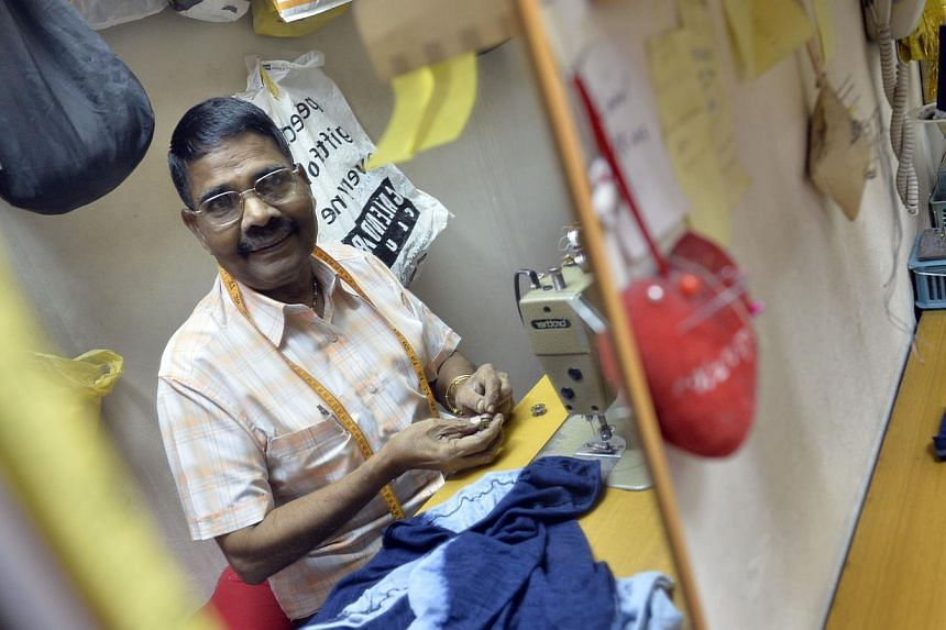 Mr Ramalingam Rathnasami Pillai (left), 68, runs a tailoring business at the mall, while Mr Chng Hak Boo (right), also 68, is the owner of Coronation Wearmart. Mr Leong Swee Meng (above) of My Cosy Corner has been serving up his popular popiah for th