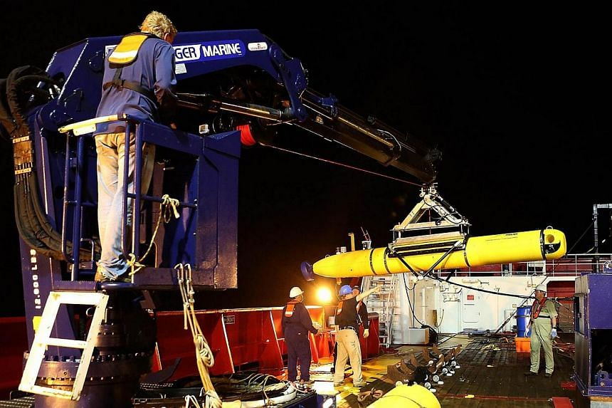 A handout photo released by Australian Defence on April 24, 2014, shows the Phoenix Autonomous Underwater Vehicle (AUV) Artemis being recovered onto Australian Defence Vessel Ocean Shield after completing a mission in the search for the missing Malay