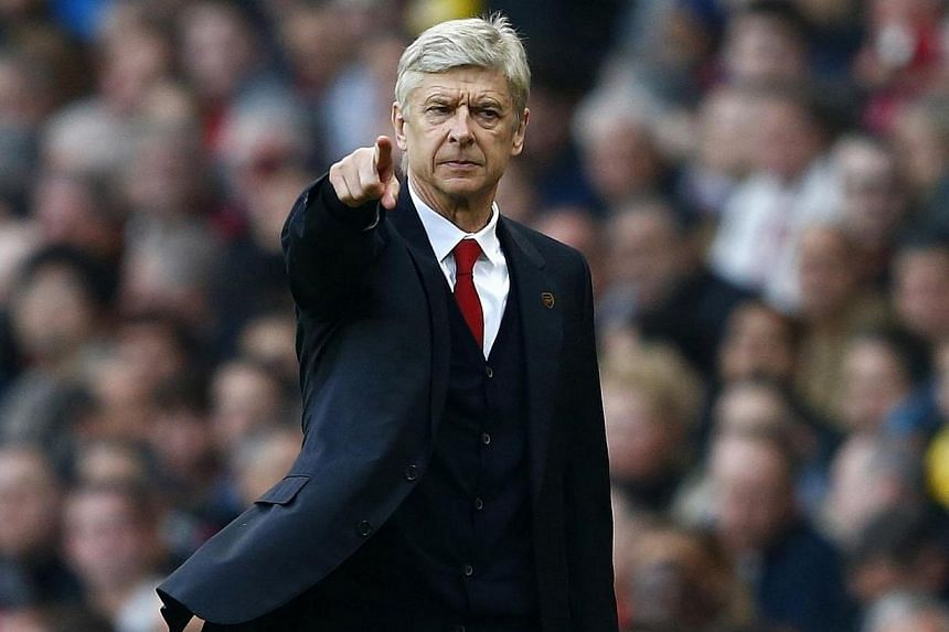 Arsenal's manager Arsene Wenger points during their English Premier League soccer match against Manchester City at The Emirates Stadium in London on March 29, 2014.Arsenal manager Arsene Wenger says the quality of football managers and coaches