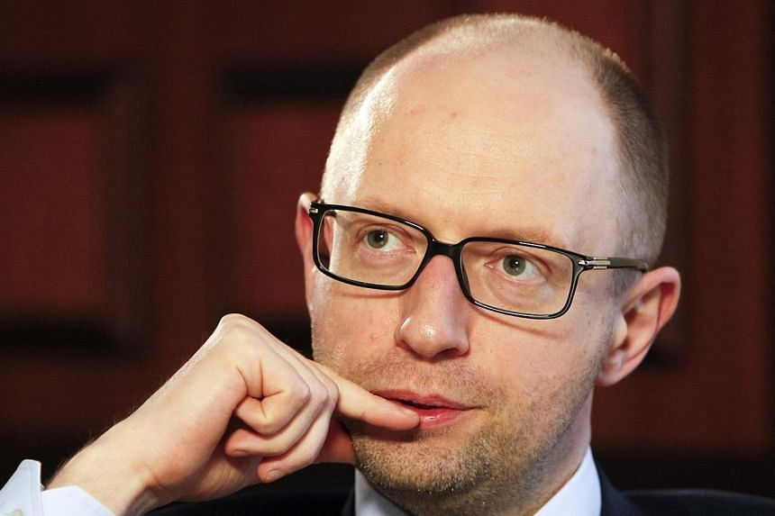 Ukrainian Prime Minister Arseny Yatseniuk listens during an interview with Reuters in Kiev on April 3, 2014.Ukrainian Prime Minister Arseny Yatseniuk said on Friday, April 25, 2014, that Russia wanted to start World War Three by occupying Ukrai