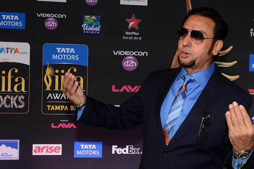 Bollywood actor Gulshan Grover posing on the green carpet at the Tampa Convention Center ahead of IIFA Rocks on the second day of the 15th International Indian Film Academy (IIFA) Awards in Tampa, Florida, on April 24, 2014. -- PHOTO: AFP