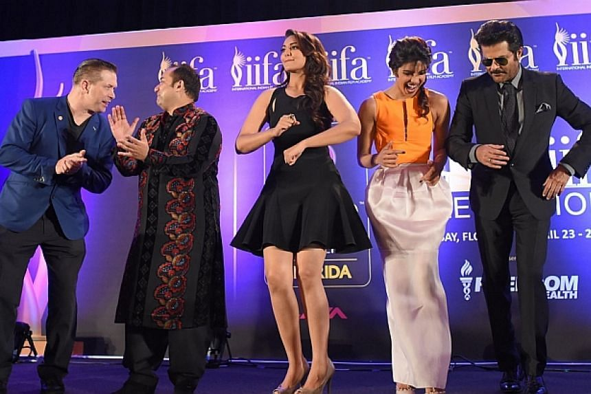 On stage during a press conference at the Hilton Downtown Hotel, (from left) US actor Stephen Baldwin, singer Rahat Fateh Ali Khan, Bollywood actresses Sonakshi Sinha and Bollywood actress Priyanka Chopra and Bollywood star Anil Kapoor dance to the t
