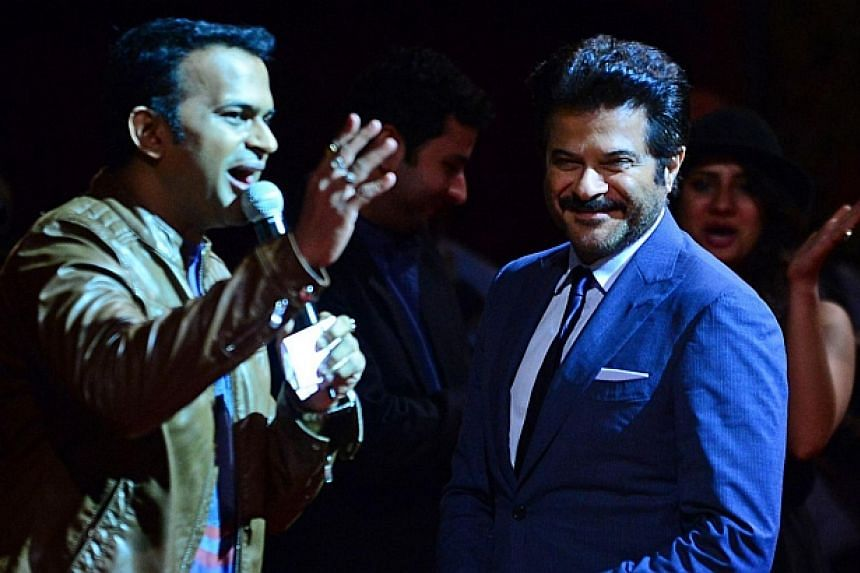 Bollywood actors Anil Kapoor (right) and Shahdid Kapoor during a Premiere and Workshop at the Tampa Theater on the second day of the 15th International Indian Film Academy (IIFA) Awards in Tampa, Florida on April 24, 2014. -- PHOTO: AFP