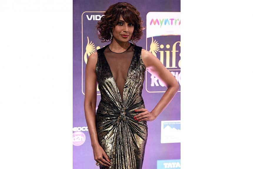 Bollywood actress Bipasha Basu on the green carpet at the Tampa Convention Center ahead of IIFA Rocks on the second day of the 15th International Indian Film Academy (IIFA) Awards in Tampa, Florida on April 24, 2014. -- PHOTO: AFP