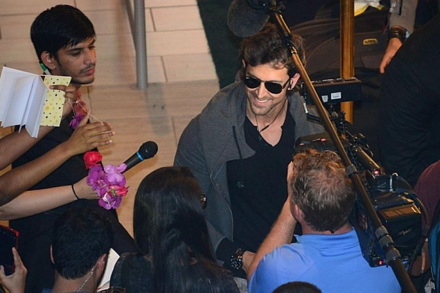 Nominee for Best Performance in a Leading Role, Bollywood actor Hrithik Roshan, surrounded by fans and members of the media at a press conference at the Hilton Downtown Hotel on the second day of the 15th International Indian Film Academy (IIFA) Awar