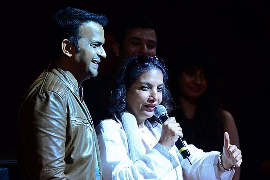 Bollywood actress Shabana Azmi, with by actor Siddharth Kannan, addressing the audience during a Premiere and Workshop at the Tampa Theater on the second day of the 15th International Indian Film Academy (IIFA) Awards in Tampa, Florida, on April 24,