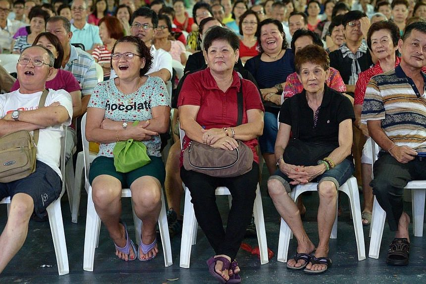 Hougang residents enjoying a getai show organised by the Punggol South Grassroots Organisation on April 12, 2014. The show was organised to help elderly residents in the neighbourhood better understand their entitlements under the Pioneer Generation