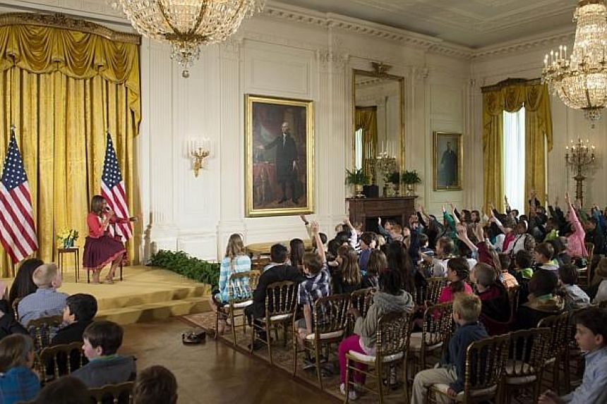 US First Lady Michelle Obama answers questions from children of Executive Office employees at the White House's annual Take Our Daughters and Sons to Work Day in the East Room of the White House in Washington, DC on April 24, 2014. -- PHOTO: AFP