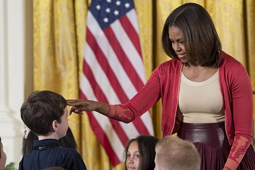 US First Lady Michelle Obama speaks with children of Executive Office employees at the White House's annual Take Our Daughters and Sons to Work Day in the East Room of the White House in Washington, DC on April 24, 2014. -- PHOTO: AFP