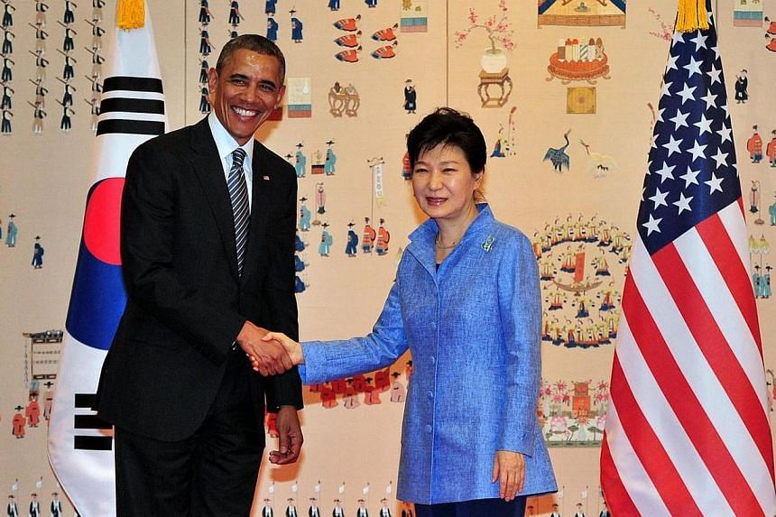 US President Barack Obama (left) and South Korean President Park Geun Hye (right) pose for a photo during their meeting at the presidential Blue House in Seoul on April 25, 2014. MsPark said on Friday, April 25, 2014, that the United States and