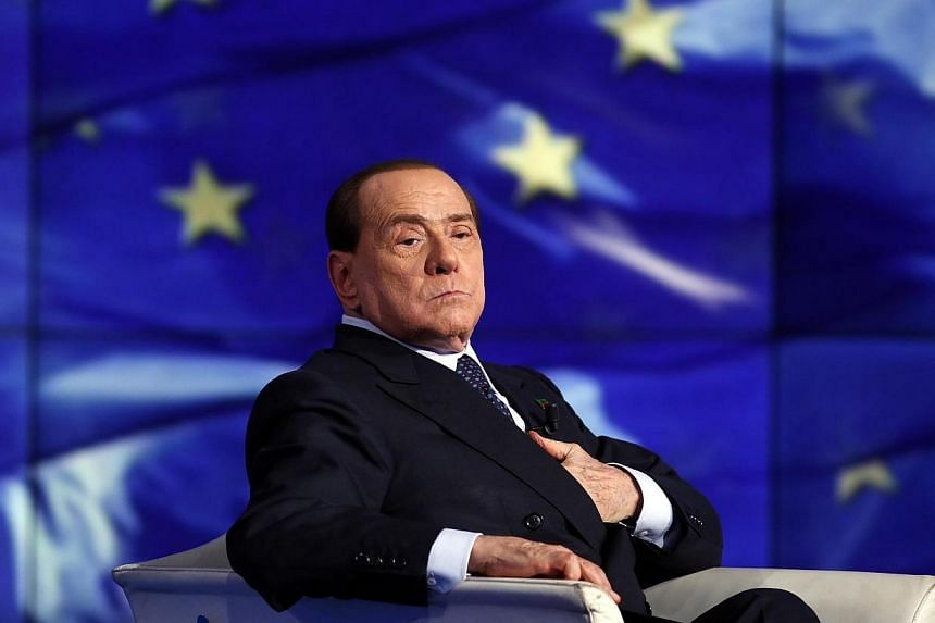 Italy's former Prime Minister Silvio Berlusconi looks on as he appears as a guest on the RAI television show Porta a Porta (Door to Door) in Rome on April 24, 2014.Berlusconi has denied that AC Milan is up for sale after reports claimed that Si