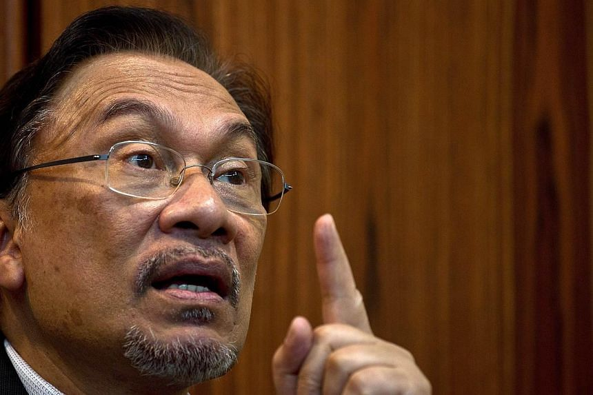 In this picture taken on April 9, 2014 Malaysian opposition leader Anwar Ibrahim speaks during an interview at his party office in Kuala Lumpur. -- FILE PHOTO: AFP