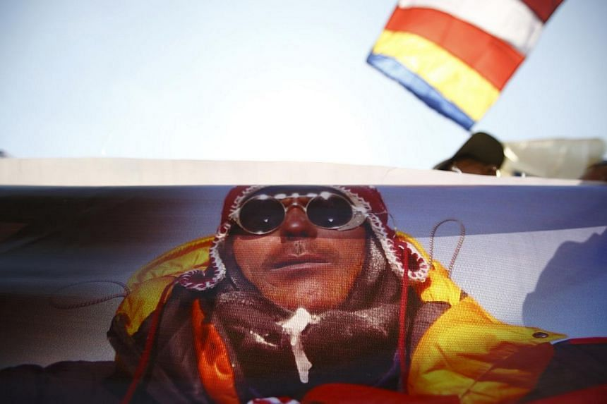 A portrait of Dorjee Khatri, who lost his life in an avalanche at Mount Everest last Friday, is seen on the truck carrying his body during the funeral rally of Nepali Sherpa climbers in Kathmandu on April 21, 2014. -- PHOTO: REUTERS