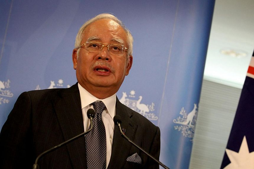 A report on the missing Malaysia Airlines Flight MH370 will be out next week said Malaysian Prime Minister Najib Razak on Thursday. -- FILE PHOTO: AFP