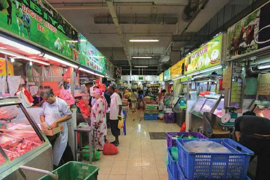 The meat and poultry section of the new Pasar Geylang Serai.-- PHOTOS: SINGAPORE PRESS HOLDINGS AND NATIONAL HERITAGE BOARD