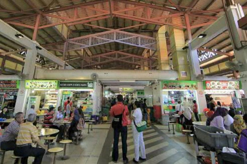 The cooked food section of the market, which is on the second floor of Pasar Geylang Serai.-- PHOTOS: SINGAPORE PRESS HOLDINGS AND NATIONAL HERITAGE BOARD