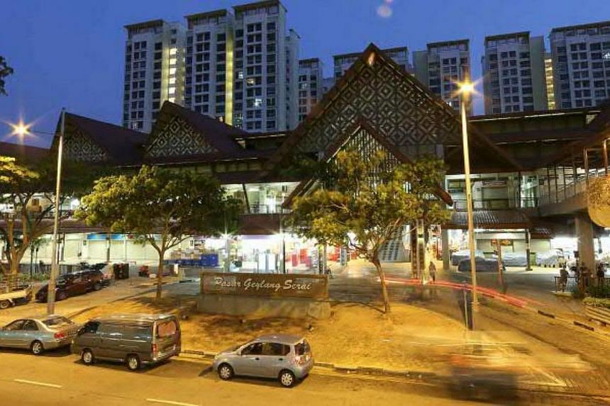 The remodelled Pasar Geylang Serai has the rustic quality of old Malay kampong houses with the use of Malay motifs. -- PHOTOS: SINGAPORE PRESS HOLDINGS AND NATIONAL HERITAGE BOARD
