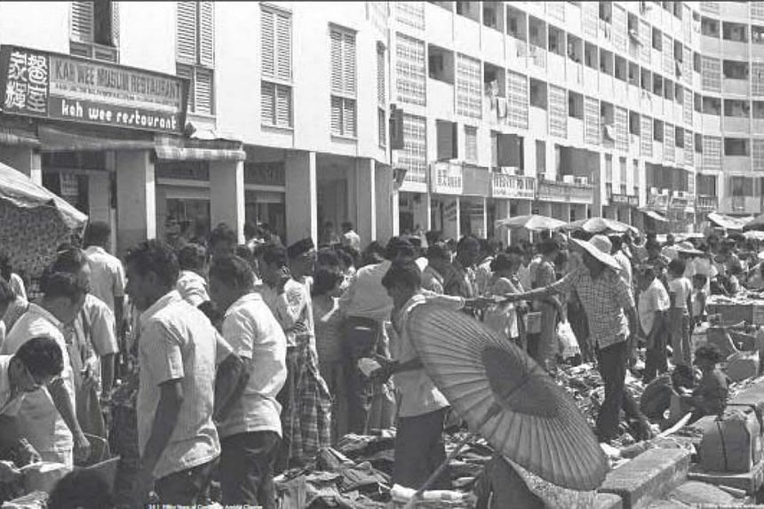 Shoppers at stalls along the flats at Geylang Serai in the 1970s during the Hari Raya season. -- PHOTOS: SINGAPORE PRESS HOLDINGS AND NATIONAL HERITAGE BOARD