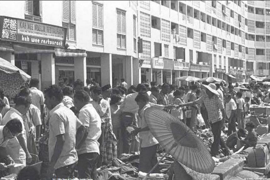 Shoppers at stalls along the flats at Geylang Serai in the 1970s during the Hari Raya season.-- PHOTOS: SINGAPORE PRESS HOLDINGS AND NATIONAL HERITAGE BOARD