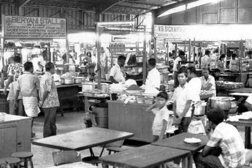 Hawker centre at Pasar Geylang Serai in 1971.-- PHOTOS: SINGAPORE PRESS HOLDINGS AND NATIONAL HERITAGE BOARD