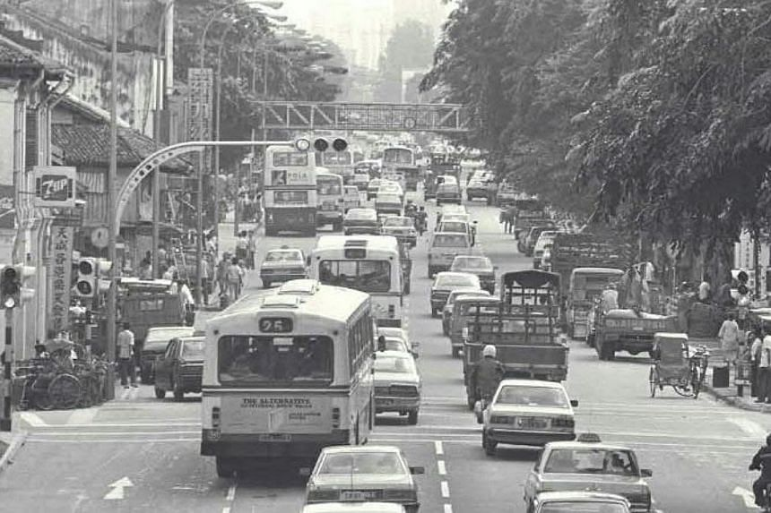 Traffic along Geylang Serai in 1984. -- PHOTOS: SINGAPORE PRESS HOLDINGS AND NATIONAL HERITAGE BOARD