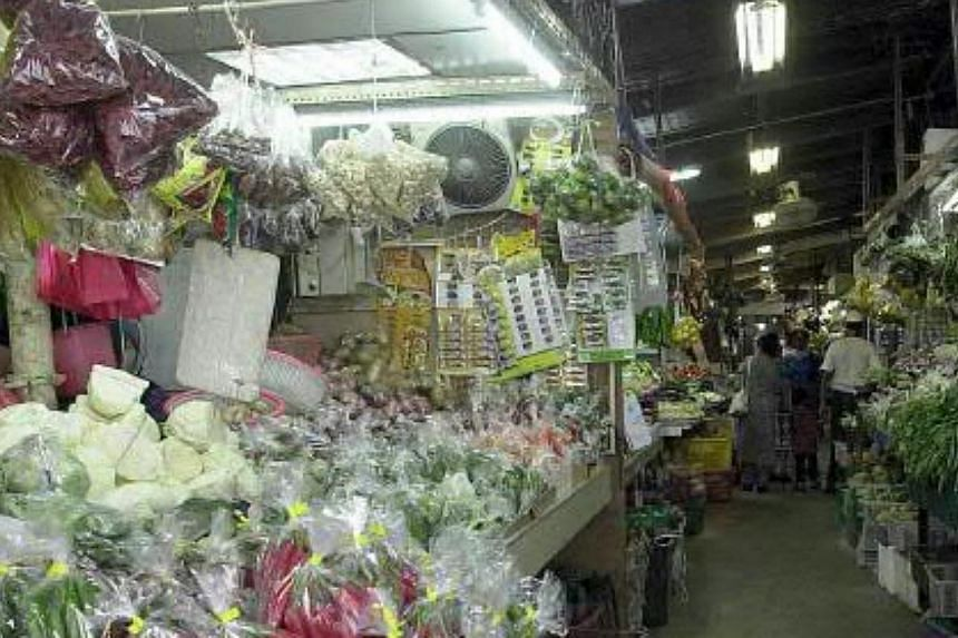 Vegetable stalls in Pasar Geylang Serai in 2002.-- PHOTOS: SINGAPORE PRESS HOLDINGS AND NATIONAL HERITAGE BOARD