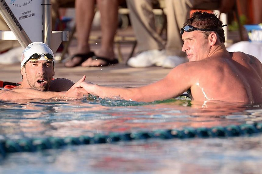 Michael Phelps and Ryan Lochte after the men's 100m butterfly race at the 2014 USA Swimming Grand Prix Series at Skyline Aquatic Centre, on April24, 2014. Michael Phelps might be rusty after a 20-month layoff, but rival Ryan Lochte says the swi