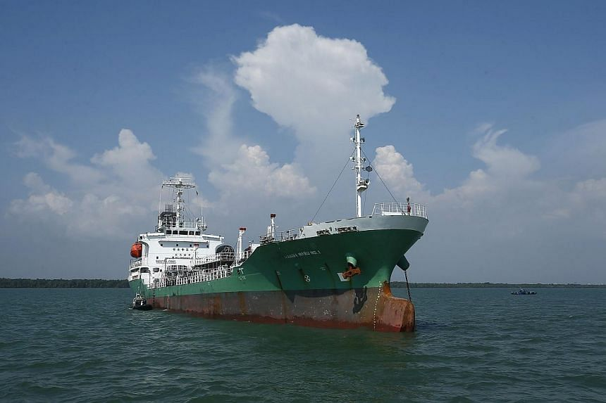 The Japanese oil tanker which was raided by armed pirates sails at Port Klang, outside Kuala Lumpur on April 23, 2014. -- PHOTO:REUTERS