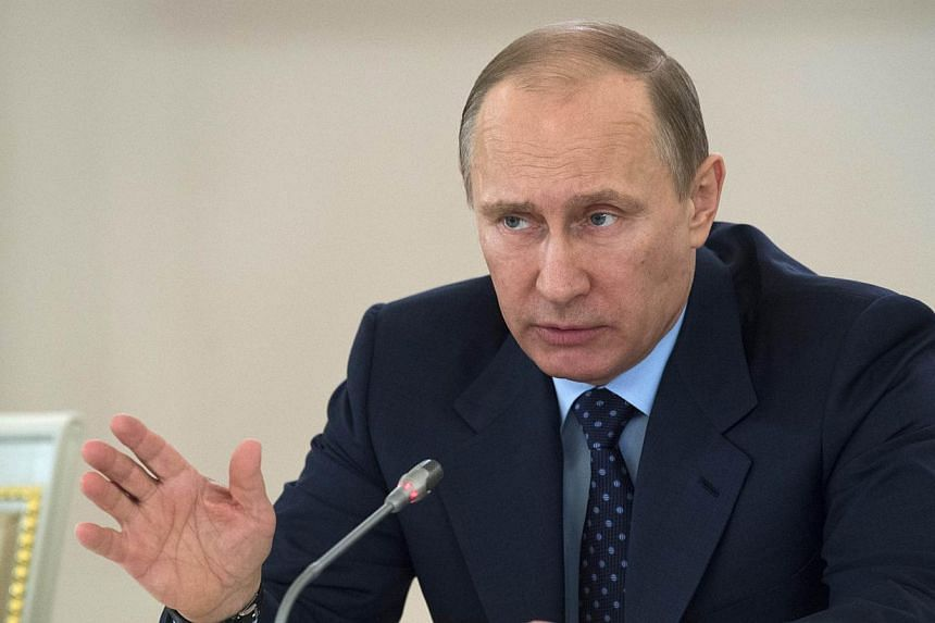 "Russian President Vladimir Putin on Thursday called the Internet a ""CIA project"" and warned Russians against making Google searches. -- FILE PHOTO: AFP"