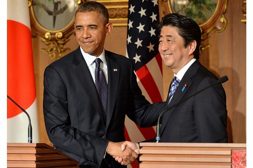 US President Barack Obama (left) shakes hands with Japanese Prime Minister Shinzo Abe following a bilateral press conference at the Akasaka Palace in Tokyo on April 24, 2014. The United States and Japan are edging into a new phase of trade negotiatio