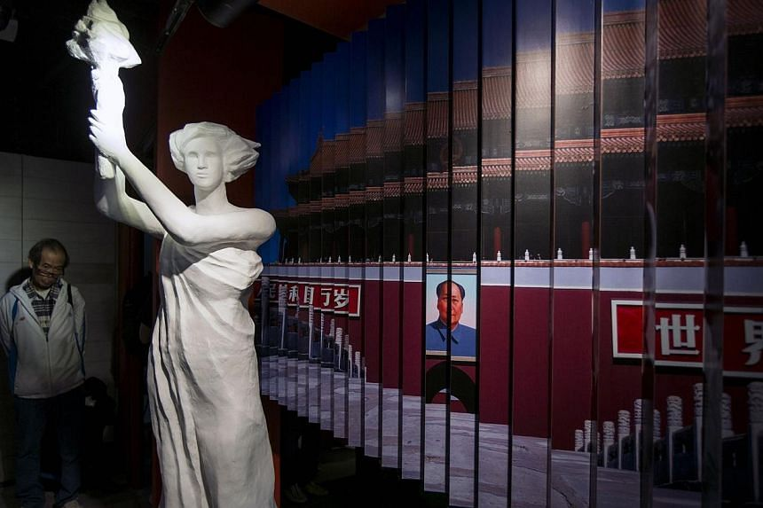A visitor looks at a statue of the Goddess of Democracy at Hong Kong's museum dedicated to the Tiananmen Square pro-democracy protests, in Tsim Sha Tsui April 26, 2014. The world's first museum dedicated to the Tiananmen Square crackdown o