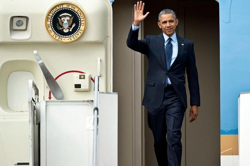 US President Barack Obama gestures as he arrives at the Royal Malaysian Air Force base in Subang on April 26, 2014. Mr Obama arrived in Malaysia on Saturday for a visit aimed at energising relations with the predominantly Muslim nation and re-fo