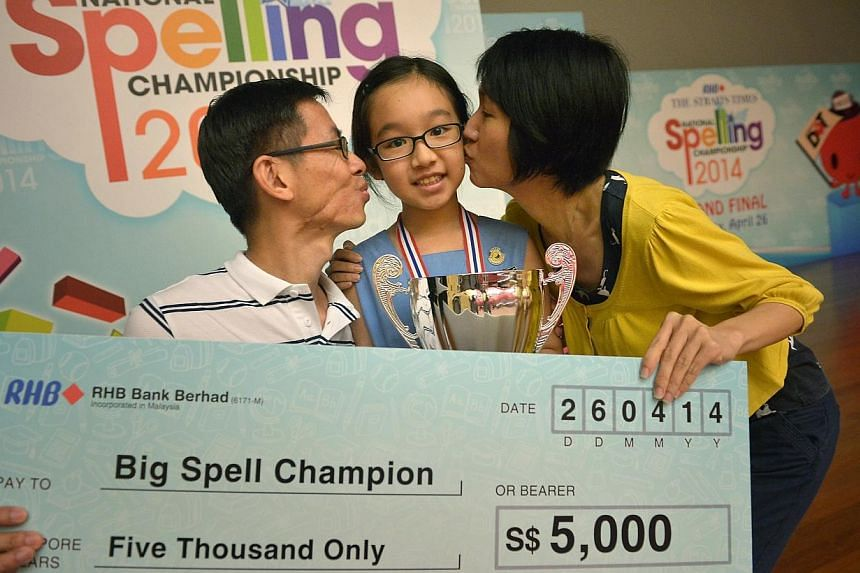 Nicole Lim (centre) from Singapore Chinese Girls' School is the first female winner of the ST-MOE National Spelling Championship which was held at the ITE college Central. -- ST PHOTO: KUA CHEE SIONG