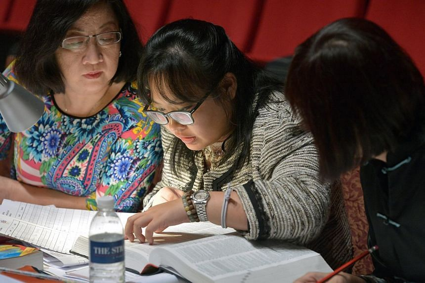 Judges checking the spelling of a word during the ST-MOE National Spelling Championship held at the ITE college Central. -- ST PHOTO: KUA CHEE SIONG