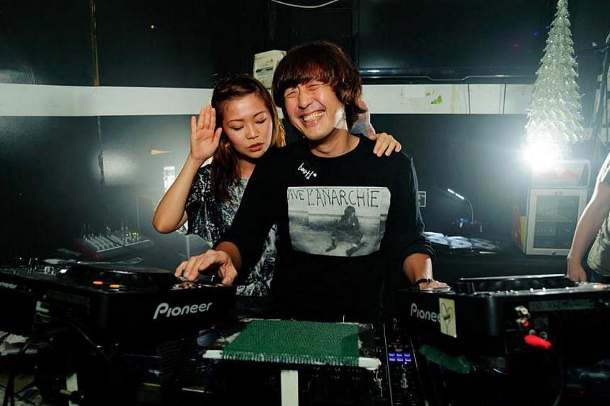 DJs Ginette Chittick and Joe Ng. -- FILE PHOTO:THOMAS TAN