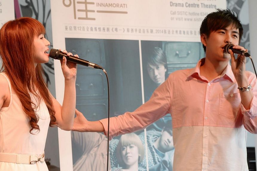 Huang Jinglun (right) singing a duet with Bonnie Loo that will be featured in Innamorati, the new musical by Toy Factory Productions. -- ST PHOTO: AZIZ HUSSIN