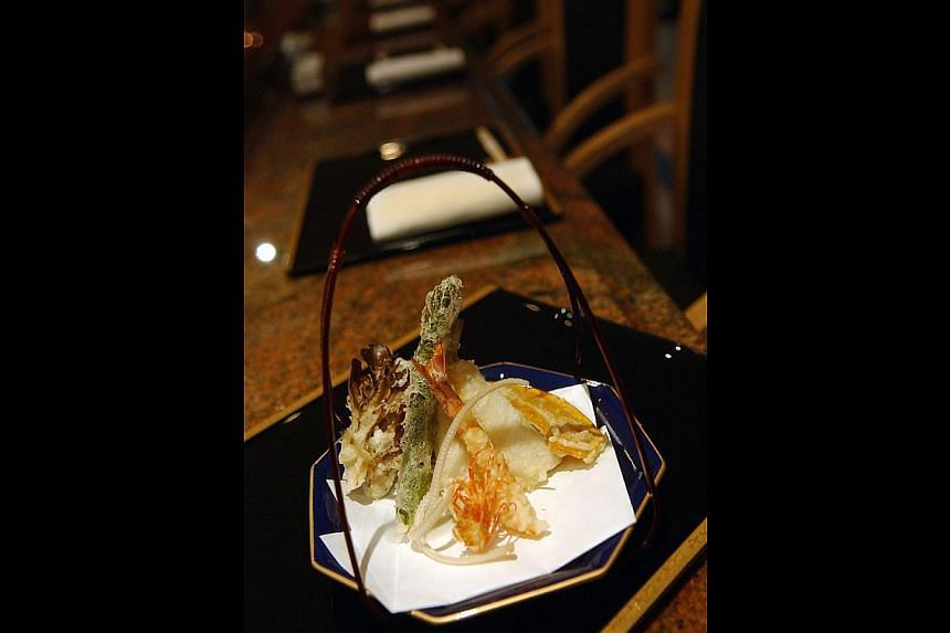 Some dishes served during Gourmet Japan include Pasta a la plancha with prawns and sake butter from BAM! Tapas-Sake Bar; Sesame tofu with uni and ikura from Izy Dining & Bar; and a platter of tempura prawns (above) from Tenshin. -- PHOTO: ST FILE