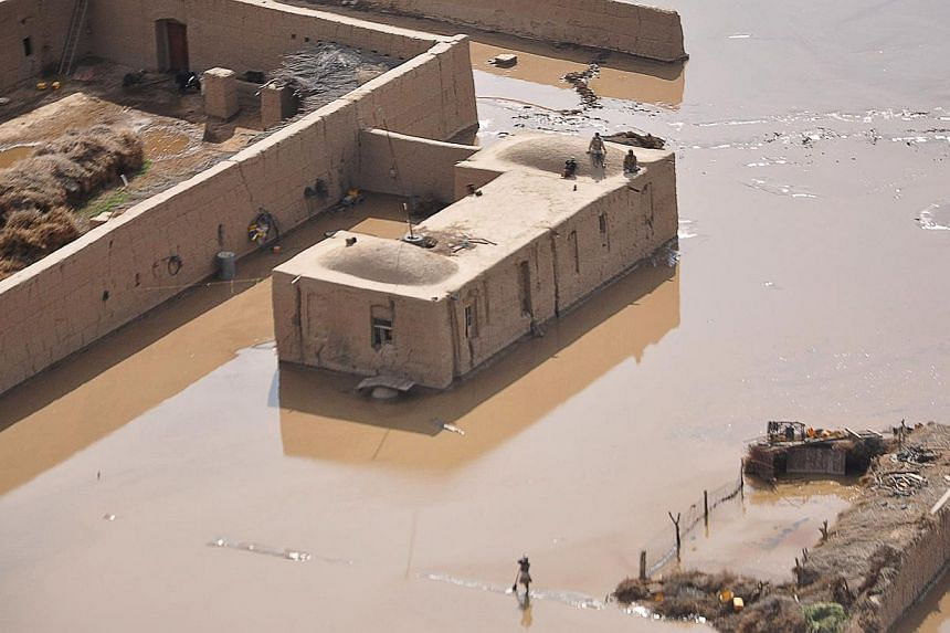 Flooding in Jowzjan province in northern Afghanistan on April 25, 2014. -- FILE PHOTO: AFP