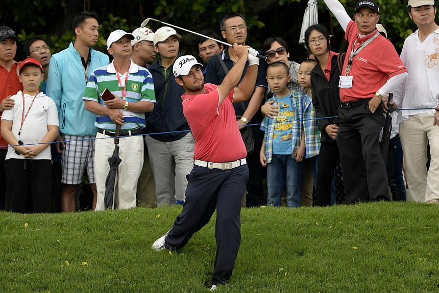Alexander Levy of France hits a shot during the third round of the Volvo China Open at the Genzon Golf Club in the southern Chinese city of Shenzhen onApril 26, 2014. -- PHOTO:AFP PHOTO/ PAUL LAKATOS/ ONEASIA